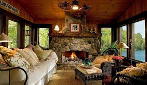 view in gallery custom stone fireplace elevates the style ient of the beautiful rustic sunroom design lands
