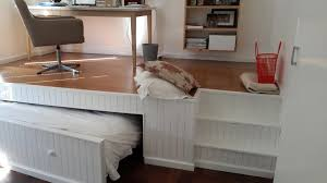 bed office. this guy combined two rooms into one by building a rollaway bed under office