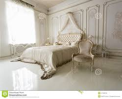 Interior Of Classic White Bedroom With Big Bed And Chair Stock Photo ...