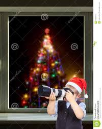 Photographing Christmas Tree Lights The Boy Is Photographing On The Background Of The Christmas