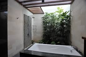 bathroom: Alluring Grey Pebble Ornaments For Innovative Tropical Bathrooms  Using Stone Wall With White Bathtub