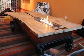 light brown wooden coffee table with fire pit on the middle combined with black steel base wonderful rustic coffee tables with wheels