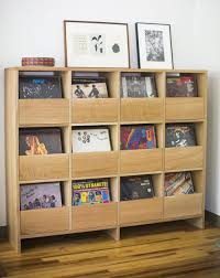 this vinyl cabinet by killscrow keeps everything in place while still displaying your favorite records