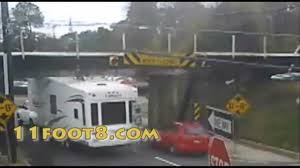 Camper tries to sneak up on the 11foot8 bridge - YouTube