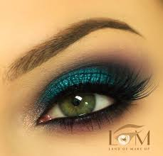 sorta like her eye makeup but the eyeliner is thicker and the eye shadow is kinda