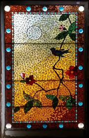 antique american stained and jeweled fl glass window with a wonderful bird and flowers made by the belcher mosaic glass co in its original frame the