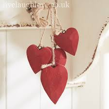 cer of red wooden hanging hearts