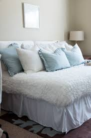 create a guest room and office combo out of your spare bedroom with these tips