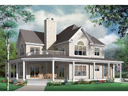 inviting farmhouse has a balcony above the wrap around porch
