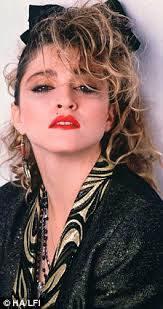 susan s hair is one of her most distinctive features and her big volumous curls are madonna eye makeup 80s