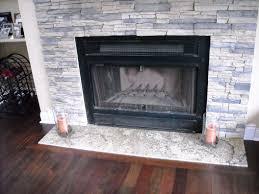 stacked stone veneer fireplace surround round designs