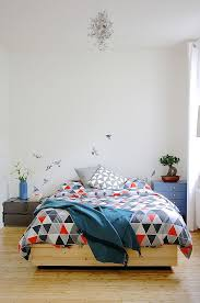 Classy Scandinavian Bedroom With Bird Wall Decor For Backdrop Steals Accent  Also Wooden Bed Frame And Geometric Pattern Bedding And Corner Nightstand  Set In ...