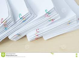 Paper Reports Pile Of Workload Paper And Reports With Colorful Paper Clip