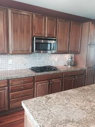 painting wood cabinets whiteShould I paint my cherry wood cabinets white