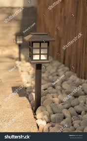 japanese style lighting. Close Up Of A Japanese Style Light Standing On Pebbles The Shade Cast By Lighting I