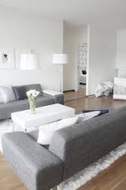 grey and white furniture. grey couch modern living room white wall the floor and furniture