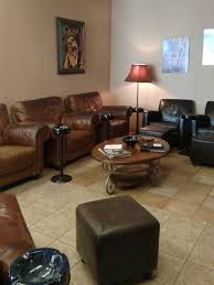 there are several leather chairs a round table and one television squire cigars also offers wine storage for up to 12 cases for 30 a month