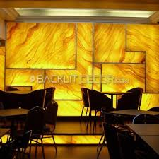restaurant wall decor using faux yellow onyx