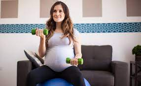 lifting when pregnant trimester by