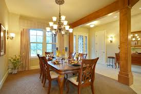 dining room lighting should emphasize the table with a central ceiling fixture such as a chandelier or another form of pendant lighting ambient room lighting