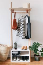Muji Coat Rack Chic and Practical DIY Clothes Racks That Put Your Wardrobe On Display 63