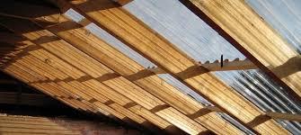 a solar attic roof made of corrugated fiberglass panels