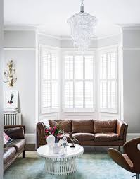 White Modern Living Room with 1960s-style Sofa and Chandelier ...