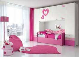 white wooden shelves over pink wooden bed connected by white pink