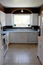 i am itching for a project so i think i am ready to start sprucing up my kitchen with a few small and inexpensive projects here is what is looks like now