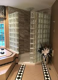 glass block walls on a custom solid surface shower pan innovate building solutions