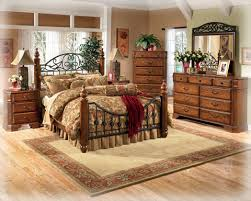 american bedroom furniture beaumont. the dresser features nine overlay drawers with profiled edges. picture frame mirror is accented a scrolling metal crown. american bedroom furniture beaumont i