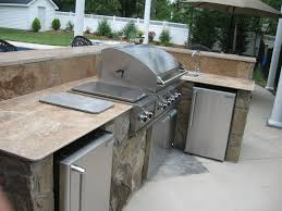 outdoor kitchen countertops ideas with tile countertop and umbrella
