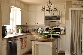 painted kitchen cabinets with black appliances. White Painted Kitchen Cabinets With Classic Island Having Brown Top Added By Pretty Chandelier And Black Appliances