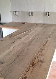 diy reclaimed wood countertop gluing and nailing down reclaimed wood boards