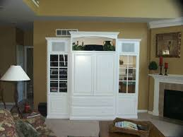 furniture high white wooden cabinet with television storage on the middle between cabinet with glass