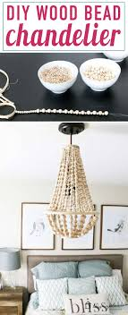 i love this diy chandelier made from wood beads it looks like it