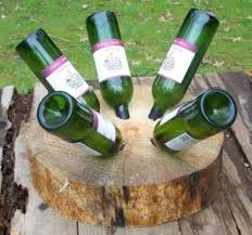 wood stump furniture. and for something completely different how about a wine rack stump few practice holes into scrap chunk of wood would be necessary to get the angles furniture