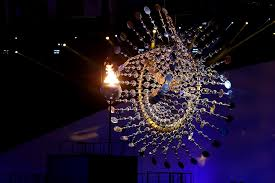flame lighting olympics. the olympic cauldron is lit alongside a sculpture by anthony howe at rio 2016 flame lighting olympics