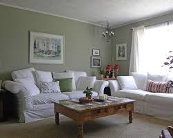 green living room chair. architecture: farmhouse living room furniture placement sage green walls white trim and red accents coffeetable against with pops of chair