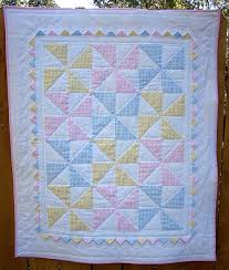 Pastel pinwheel quilt with prairie points. Cute baby quilt. I ... & Pastel pinwheel quilt with prairie points. Cute baby quilt. I could totally  do this Adamdwight.com