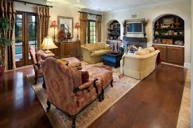 living room tuscan style ceramic full area floor pink fabric sectional carpet brown leather sofa white
