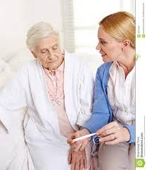 Geriatric Nursing Geriatric Nurse With Fever Stock Image Image Of Home 38373287
