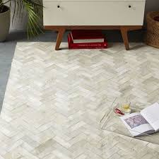 pieced patched cowhide rug chevron west elm with area decorations architecture cowhide area rug