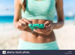 Athlete Using Mobile Phone App Fitness Tracker For Tracking