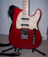 my quasi brent mason tele decided to go the vintage pearl pickguard from warmoth think it pulls it all together a wee bit better than the white pearl wiring still the same as