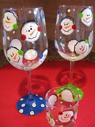pinned these from painted them last night they are so cute snowman craftsxmas craftsbottle paintingwine glass