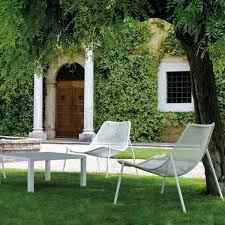 emu round lounge chair lounge armchair and table in garden