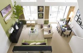 View in gallery Drapes and couch in accent wall color highlight the light  moss green in the living space