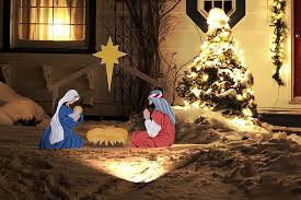 outdoor nativity scene with light in snow