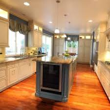 Chic Transitional Kitchen With Built-In Wine Refrigerator in Island